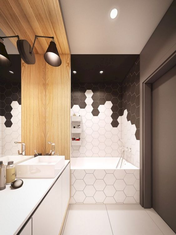 bathroom, white floor tile, white hexagonal tiles tub, white and black hexagonal wall tub tiles, black ceiling, white cabinet, wooden box, black sconce, grey wall