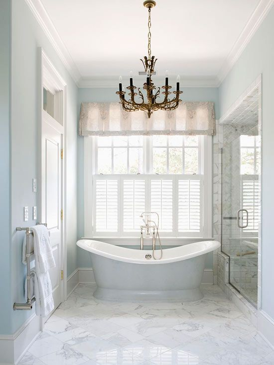 bathroom, white marble floor, white wall, white window, chandelier, glass partition on shower area