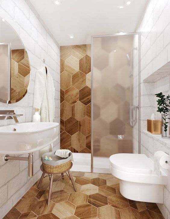 bathroom, white subway wall tiles, wooden hexagonal wall tiles on the wall and floor, white tub, white toilet, white sink, glass partition