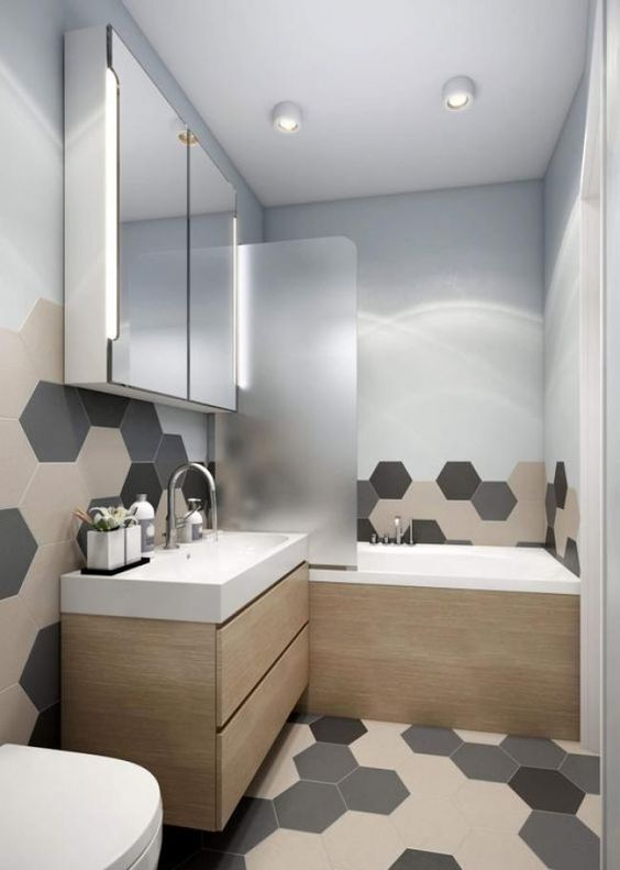 bathroom, white wall, grey beige black hexagonal tiles on the floor and wall, wooden floating cabinet with white top sink, wooden tub with white inside