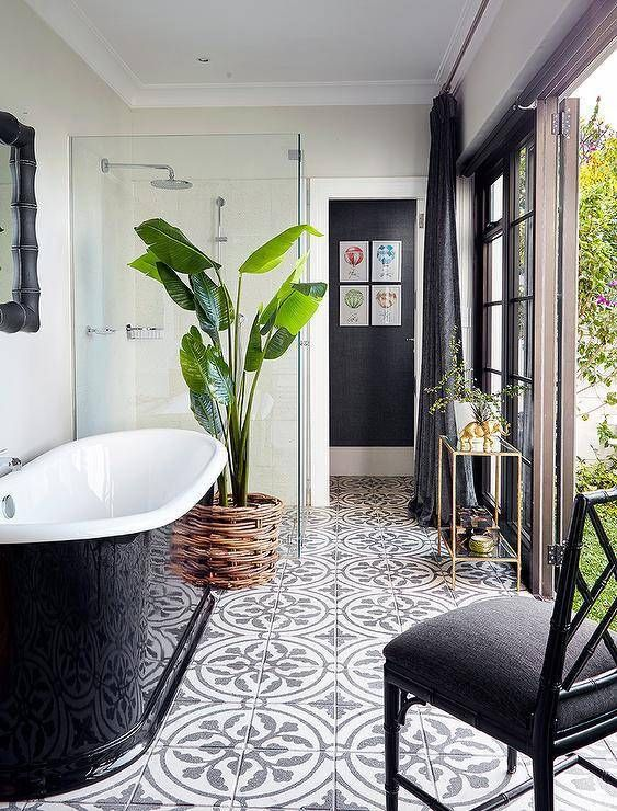 bathroom, white wall, patterned floor tiles, black tub, glass partition, shower, black chairs, golden table