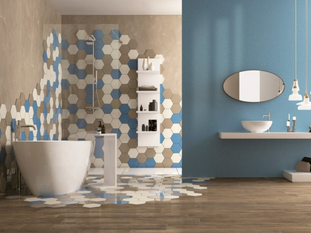 bathroom, wooden floor, brown wall, blue brown white hexagonal tiles on wall and floor, blue painted wall, white tub, white floating shelves