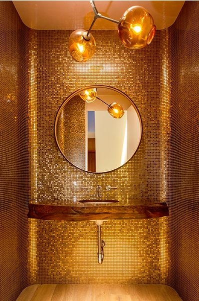 bathroom, wooden floor, golden mosaic on the entire walls, molten gold pendant, round mirror, wooden floating sink