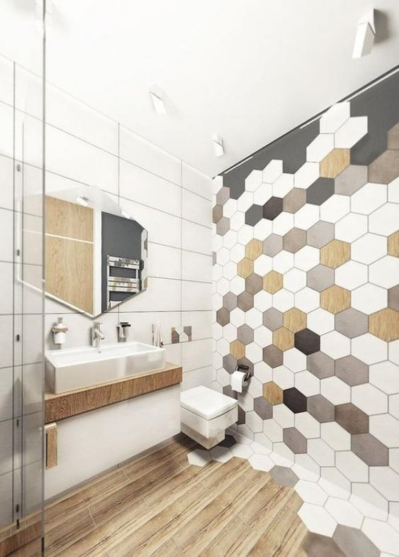 bathroom, wooden floor, white rectangular wall tiles, white brown black hexagonal tiles, white ceiling, floating cabinet and sink, hexagonal mirror