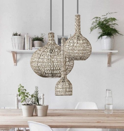 beige rattan pendants, wooden table, white chairs, white wooden floating shelves