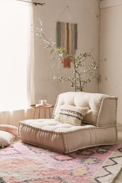 beige tufted cushion shaped like chairs, rug, beige wall