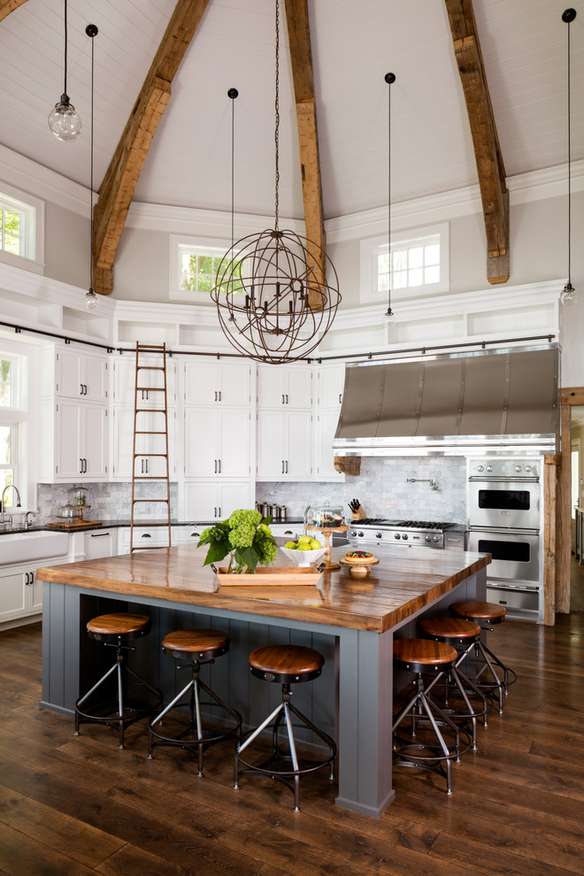 big kitchen islands wooden floor barstools wooden beams rustoc chandelier gray island wooden countertop ladder backsplash range hood stovetop windows