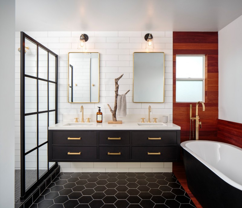 black bathroom cabinets gold hardware golden framed wall mirrors gold faucet black honeycomb floor tile window gold tub filler black tub white subway tile gold shower head