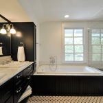 Black Bathroom Cabinets Wall Sconces Built In Tub Mosaic Floor Tile White Subway Wall Tile Window White Marble Countertop Wide Wall Mirror Sinks