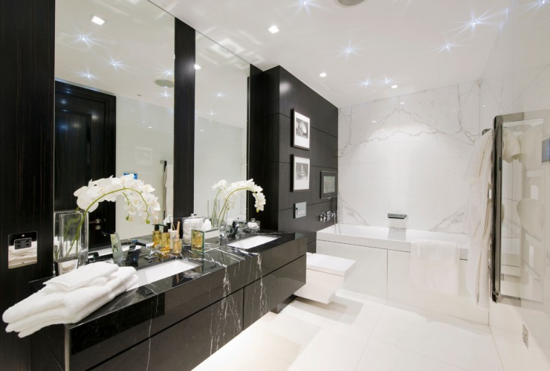black bathroom cabinets white warble wall black marble built in tub toilet black apneling black marble floating cabinet white undermount sinks faucet wall mirrors