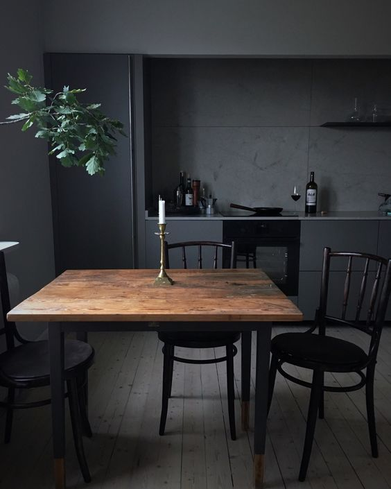 black kitchen, dak wooden floor, black cabinet, dark grey wall, black wooden chairs, wooden table