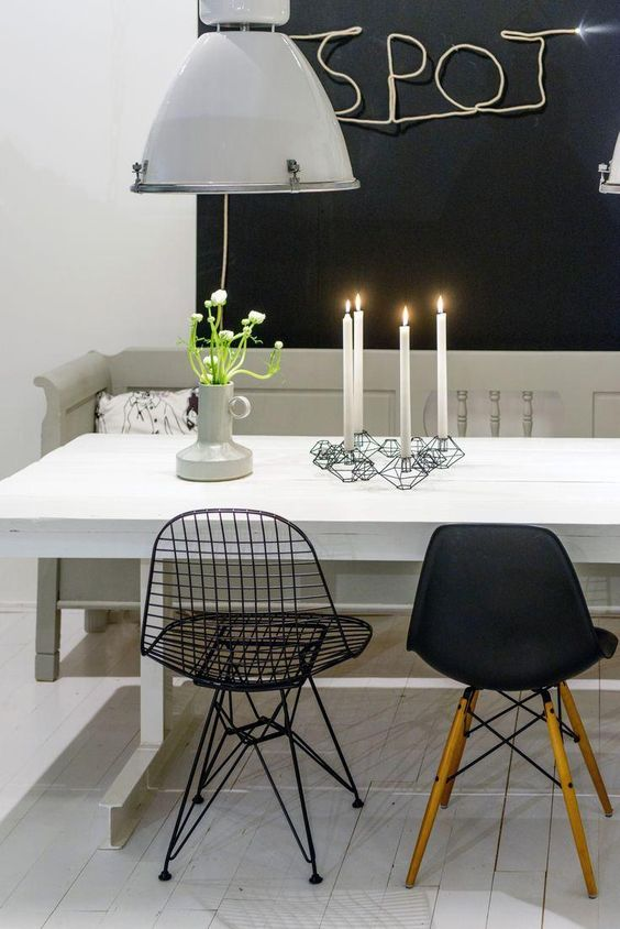 black mid century modern chairs, grey bench, white table, black wired chairs, white pendant, black  background