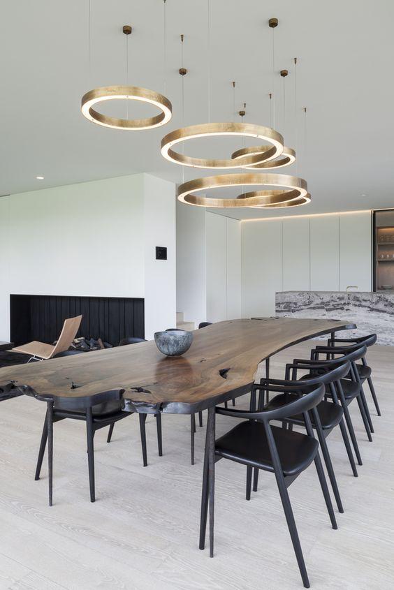 black wooden chairs, wooden slab table, wooden floor, golden ring pendant