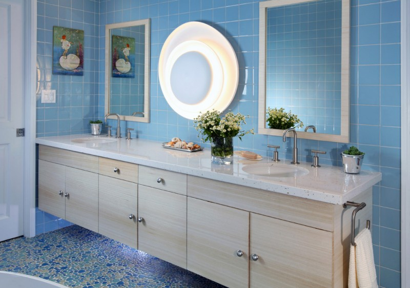 blue wall tile light fixture wall mirrors floating vanity white granite cuntertop double sink faucet towel ring artwork blue glass mosaic floor tile