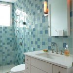 Blue Wall Tile Window Glass Shower Door Toilet Wall Sconce Wall Mirror White Vanity Undermount Sink Shower Fixtures Faucet White Floor Tile