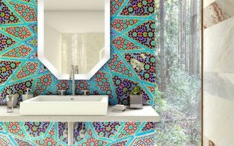 bright Moroccan mosaic on statement wall with floating vanity and sink, octagonal mirror, brown marble wall