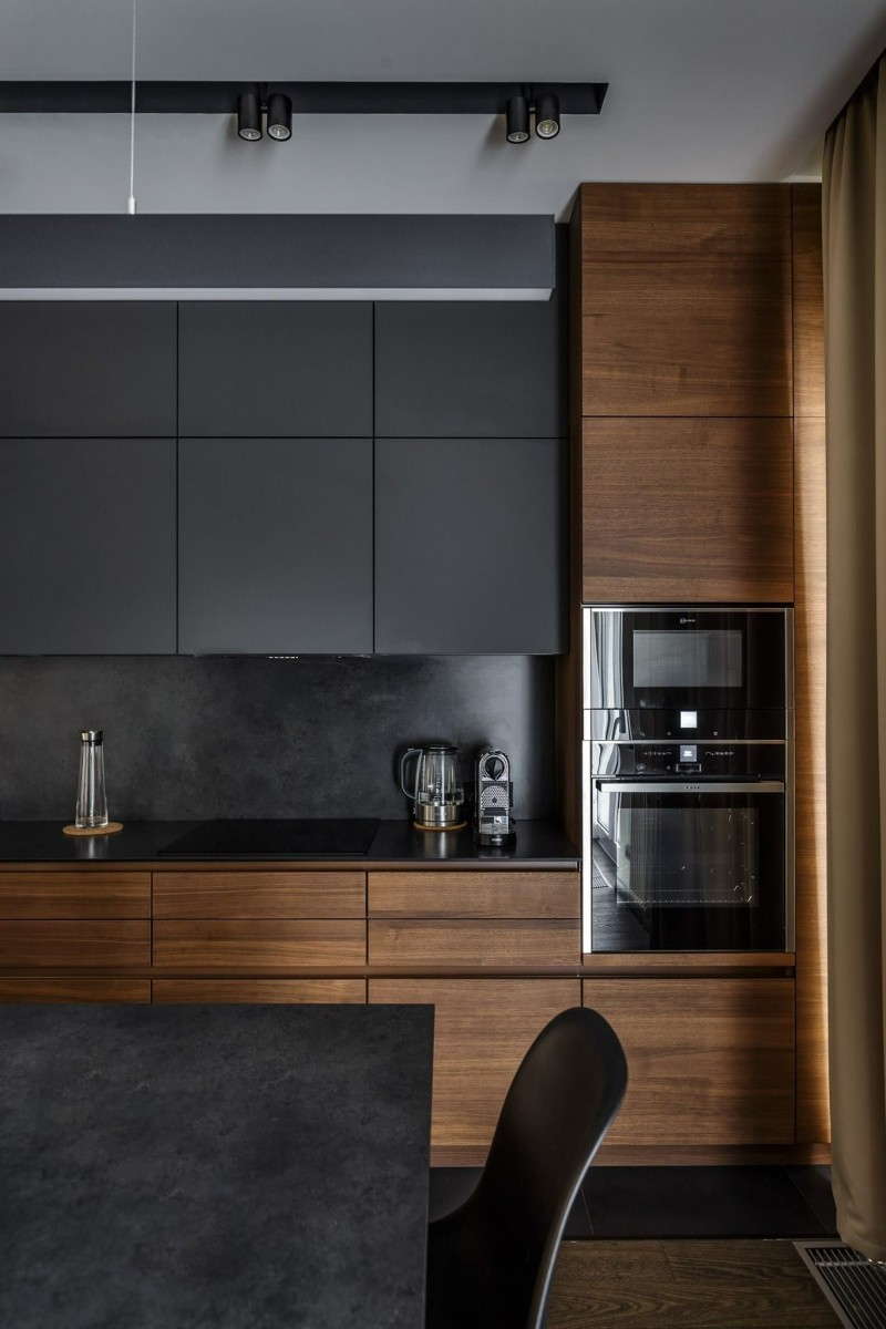 dark kitchen, dark floor, dark wooden cabinet, black upper cabinet, black marble backsplash, black marble island, black chair