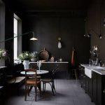 Dark Kitchen, Grey Floor, Black Bottom Cabinet With White Countertop, White Sink, Dark Brown Cabinet, Black Pendant, White Dining Table, Dark Chairs