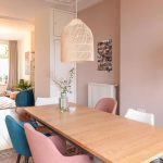Dining Room, Pink Rug, Wooden Table With Blue Wooden Legs, Pink, Blue, White Chairs, Pale Pink Wall, Rattan Pendant, White Ceiling With Molding