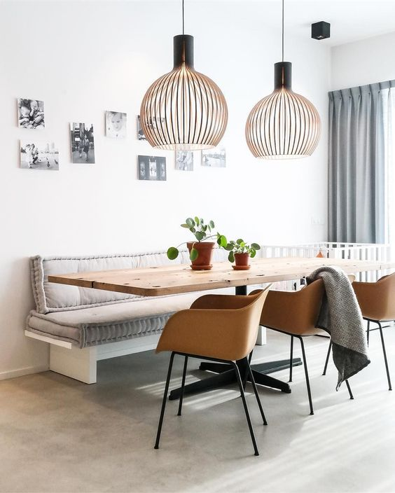 dining room, seamless floor, white wall, white bench with grey cushion, wooden table, brown chairs, golden wire pendants, grey curtain
