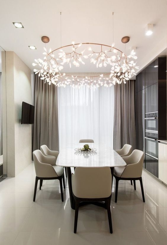 dining room, white floor, white chairs, white marble table, white wall, beige curtain, round branches chandelier