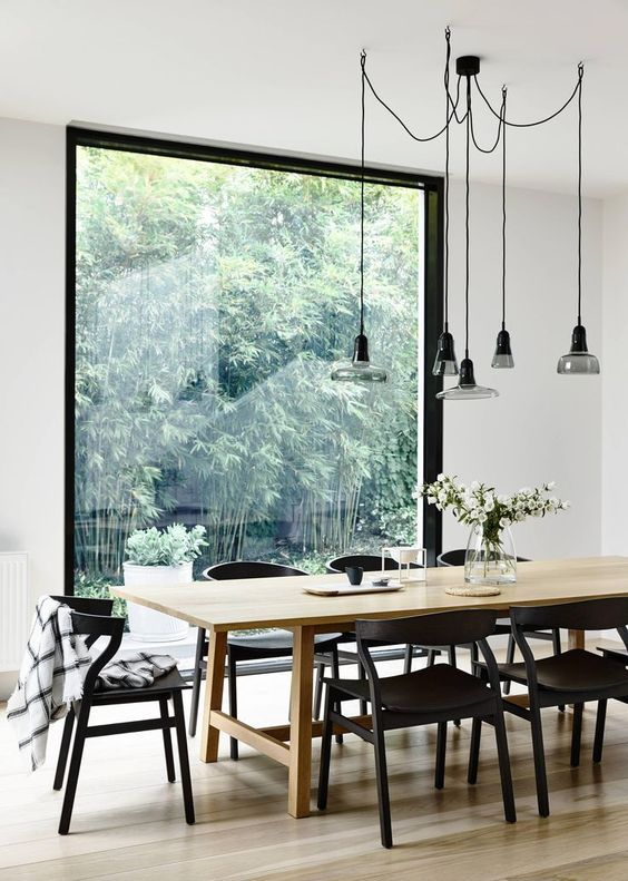 dining room, wooden floor, black glass pendants, wooden rectangular table, black wooden chairs, large glass window