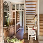 Entrance, Wooden Flor, Wooden Cabinet With Details, Mirror, Shelves Under The Stairs, Open Stairs, White Wooden Bench