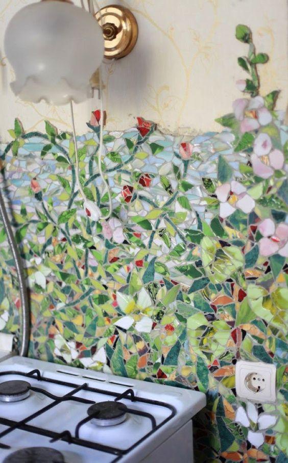 flower mosaic tiles for backsplash, beige wall, sconce, white stove