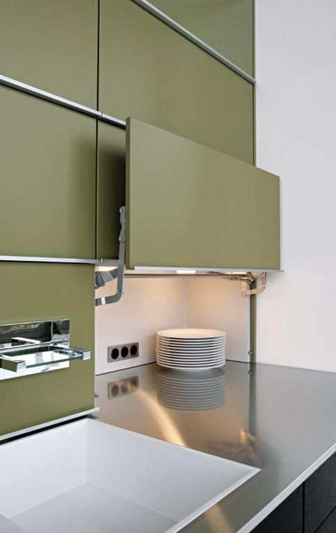 high end kitchen storage, green vertical door storage, white square sink, stainless steel top, black cabinet