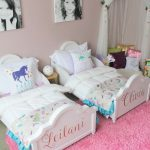 Kids Bedroom, Pink Rug, Pink Wall, White Bed Platform With Name, White Bedding, Pictures, Corner Canopy