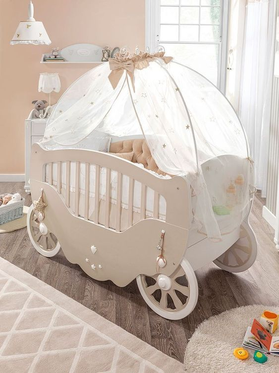 kids bedroom, wooden floor, brown rug, beige wall, white curtain, white pendant, brown crib in carriage shape with white curtain