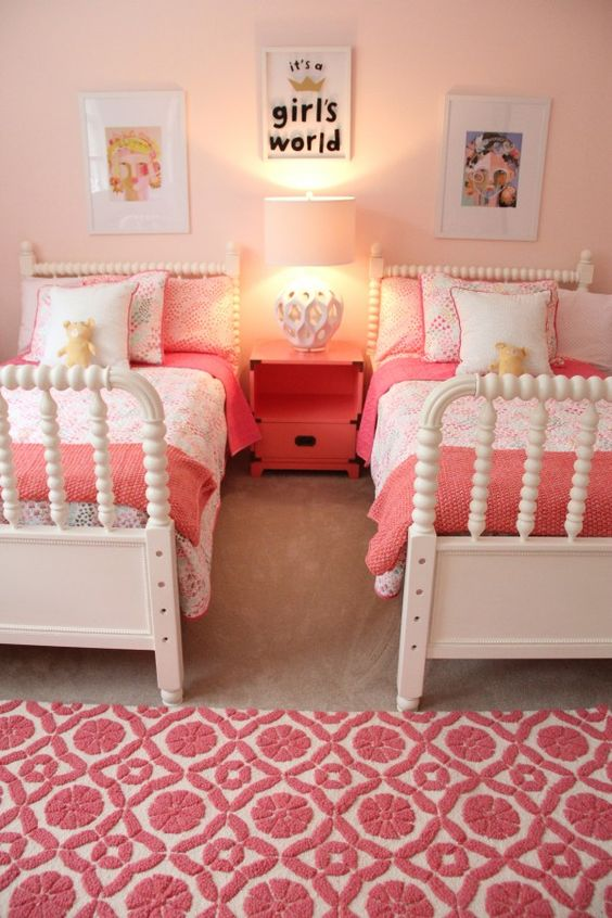 kids bedroom, wooden floor, white bed platform, pink wall, pink bedding, pink rug