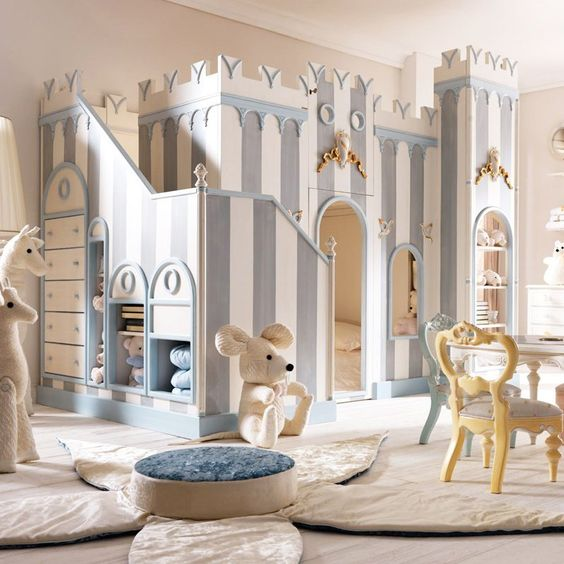 kids bedroom, wooden floor, white flower rug with table, white table with colorful chairs, white blue striped castle bed with shelves