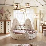 Kids Bedroom, Wooden Floor, White Round Tufted Bed Platform, Pink Bedding, White Cabinet, White Table, Floor Lamp, Pendants, Rug