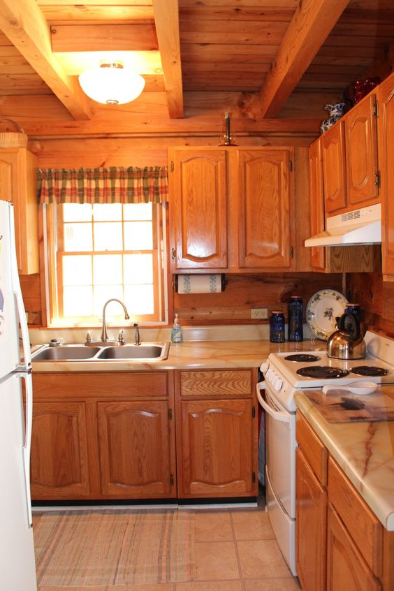 kitchen, beige floor, wooden cabinet, wooden backsplash, marble top, wooden ceiling with wooden beams
