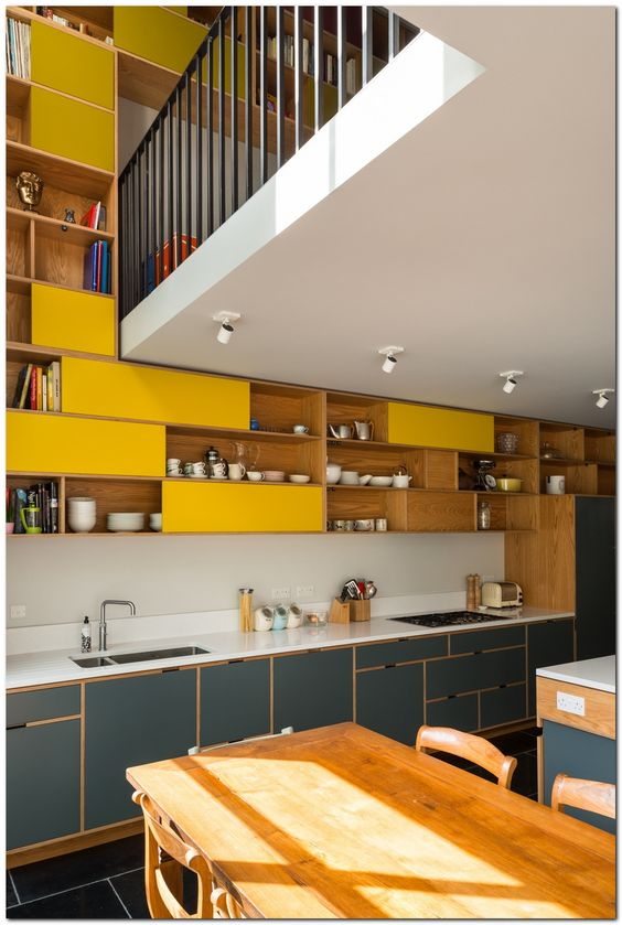 kitchen, black floor tiles, grey bottom cabinet with white top, white backsplash, yellow shelves