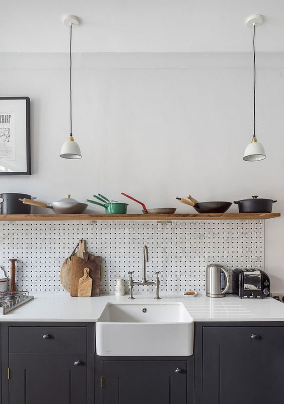 kitchen, dark grey bottom cabinet, white wall, white pegboard backsplash, white kitchen top, white apron sink, floating shelves, white pendants