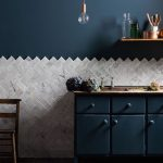Kitchen, Grey Marble Floor, Grey Herringbone On Half Bottom Of The Wall, Dark Blue Cabinet With Wooden Top, Dark Blue Wall, Bulb Pendant, Floating Shelves