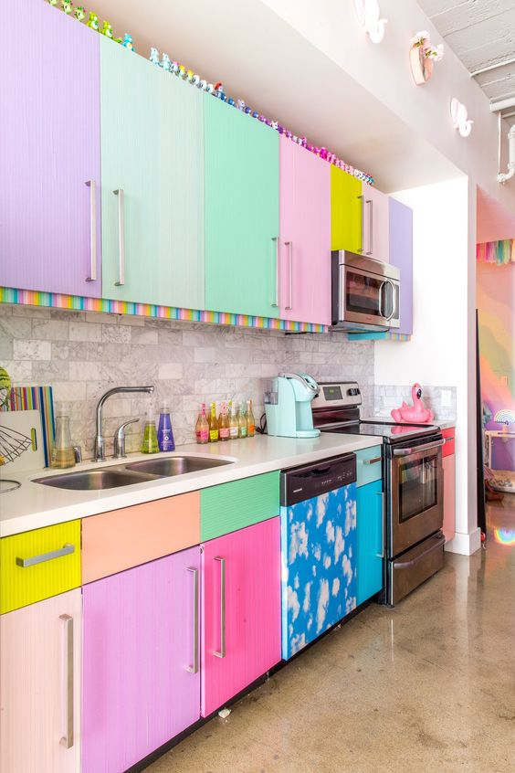 kitchen, marble seamless floor, brown tiles backsplash, colorful cabinet, white ceiling, white kitchen top
