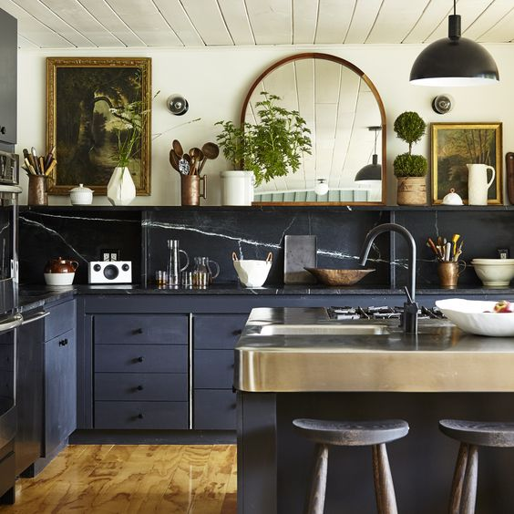 kitchen, navy cabinet with navy marble top, navy marble backsplash, navy island with steel top, open shelves, mirror, pendant, white wall, white wooden ceiling