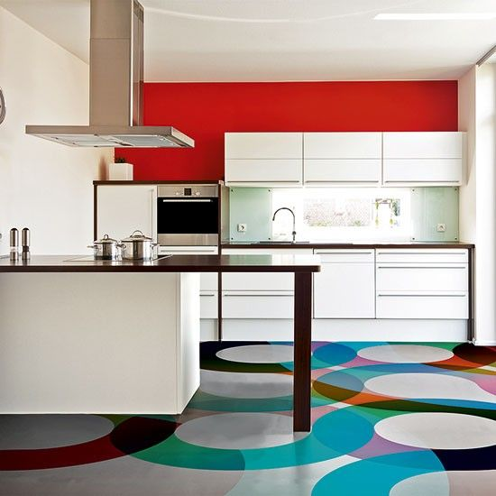 kitchen, patterned floor, white cabinet, glossy white backsplash, red wall, white wall