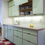 Kitchen, Red White Plaid Floor, White Wall, Soft Green Upper Bottom Cabinet, White Backsplash, Wooden Top