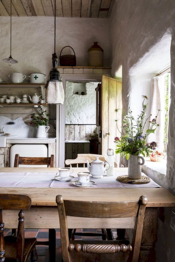kitchen, warm floor tiles, white color, open shelves, wooden dining table