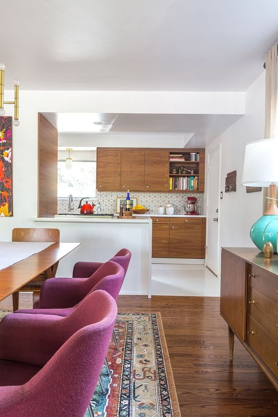 kitchen, white floor, white kitchen top, wooden cabinet, hexagonal backsplash tiles, pendant, dining table with purple chairs