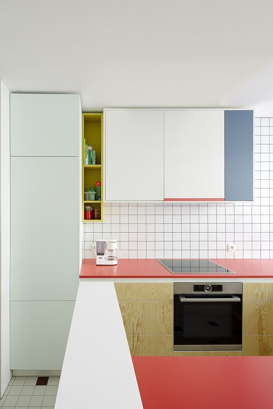 kitchen, white square floor tiles, white square wall tiles, white, blue upper cainet, pink kitchen top, wooden bottom cabinet, whtie pantry