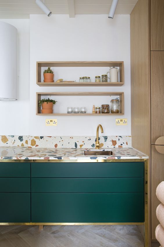 kitchen, wooden chevron floor, green cabinet, terazzo top, white wall, floating wooden box shelves, wooden pantry