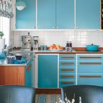 Kitchen, Wooden Floor, Blue Cabinet, Wooden Top, White Backsplash Tile, White Ceiling, Blue Shade, Blue Pendant, Black Table Set