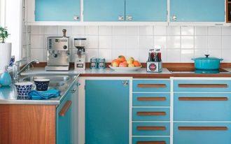 kitchen, wooden floor, blue cabinet, wooden top, white backsplash tile, white ceiling, blue shade, blue pendant, black table set