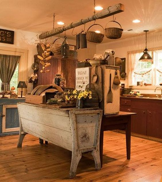 kitchen, wooden floor, brown wooden bottom kitchen, blue bottom kitchen, white wall, wooden hanging beam, wooden table in the middle