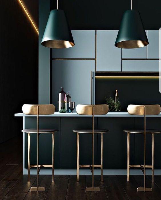 kitchen, wooden floor, dark green island, blue top, blue cabinet, green pendant with golden inside, golden chairs